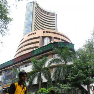 Sensex edges lower, Axis Bank, SBI up over 1%