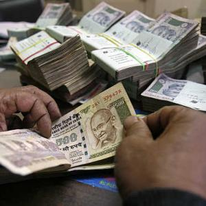 India in tight spot as rupee slides to record low