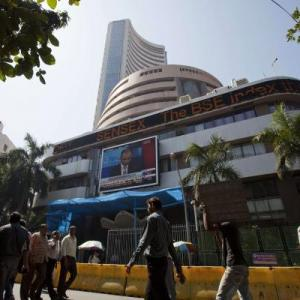 Sensex, Nifty rise riding on global cues