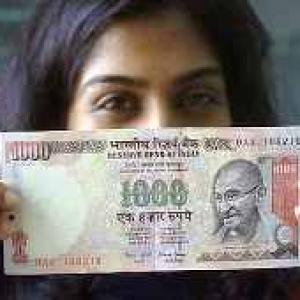 Rupee partially recovers after sinking below 56-mark