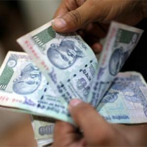 Rupee tumbles by 28 paise to 2-month low of 66.47 against USD
