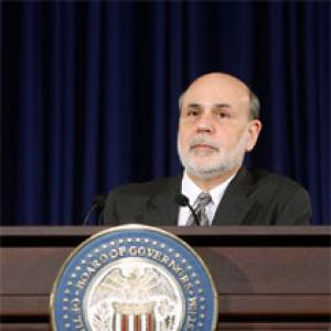 In Bernanke's final act, Fed cuts stimulus despite market turmoil
