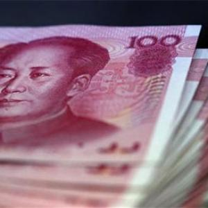 Yuan devaluation to hit firms with foreign loan exposure