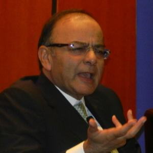 Jaitley talks tough on black money, sells India story