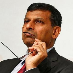 Sell stakes in PSUs to boost growth: Rajan tells FM