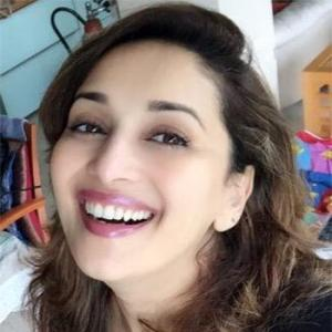Want to know the secret of Madhuri Dixit's ageless beauty? Click here
