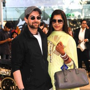 PIX: Newlyweds Neil-Rukmini return to Mumbai