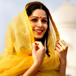 What's Freida Pinto doing in India?