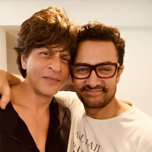 Beat That! SRK gets a warm hug from Aamir