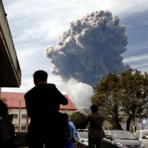 After tsunami and quake, volcano erupts in Japan