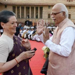All's well in the House: Modi grabs Rahul's hand; Sonia, Advani chat
