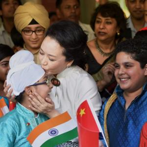 Sealed with a kiss: China's First Lady has all in smiles at Delhi school