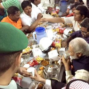 PHOTOS: PM Modi snacks with workers in Saudi and much, much more