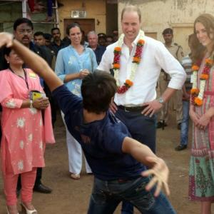 PHOTOS: The Royals have a 'Slumdog' moment in Mumbai