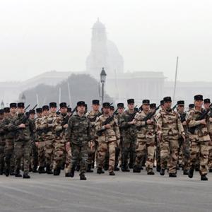 Why are French troops marching down Rajpath?