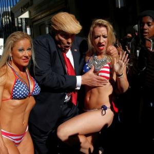 PHOTOS: 'Trump' takes Times Square with a band of bikini-clad babes