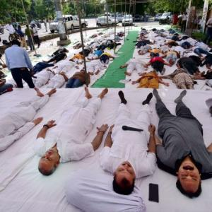 UP farmers perform shavasana in protest