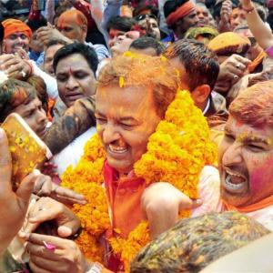 BJP storms to power in UP with 312 seats