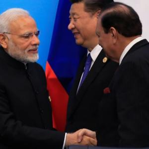PM Modi, Pak President shake hands at SCO Summit