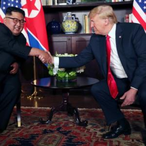 Kim vows complete denuclearisation at historic summit with Trump