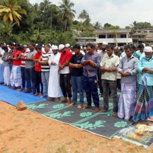 Muslims offer Friday prayers under military protection in Sri Lanka after riots