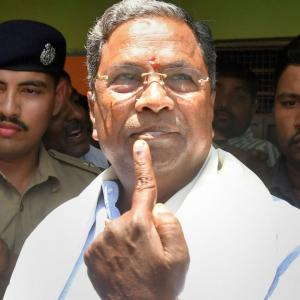 Karnataka polls: Yeddyurappa wins, Siddaramaiah is trailing