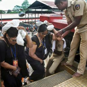 Devotees prevent woman at Sabarimala; police file cases