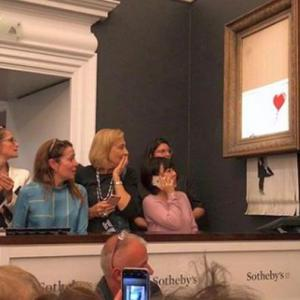 Banksy painting 'shreds itself' after being sold for $1.4 million