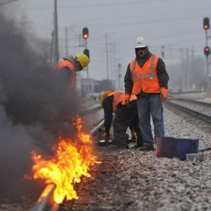 It's so cold in Chicago they're lighting train tracks on fire