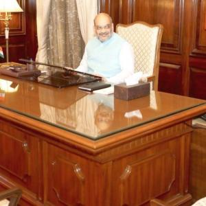 Amit Shah, Rajnath take charge as Union ministers