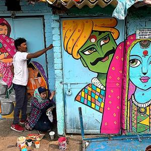 Colourful murals bring a smile to a Delhi slum