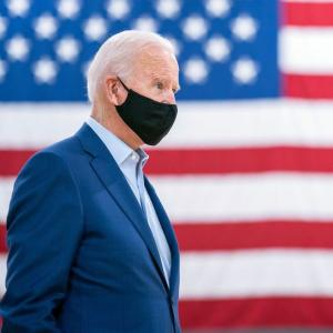 Biden launches 'wartime' plan against COVID-19