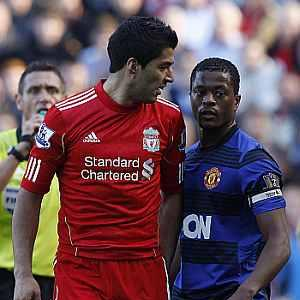 Suarez charged by FA over alleged racist taunt