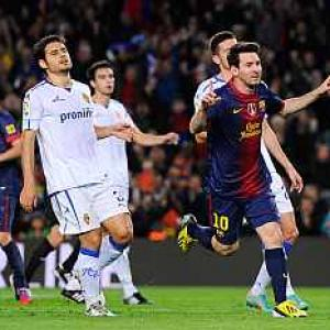 Messi nets another double as Barcelona march on