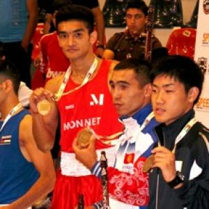 Shiva wins split decision for gold at Asian boxing