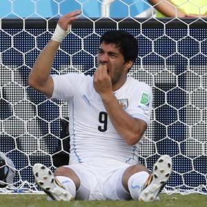 Suarez's bite gets him four months ban from football