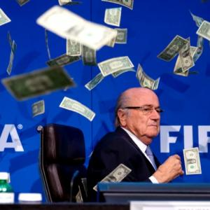 PHOTOS: Protester showers FIFA's Blatter with fake money
