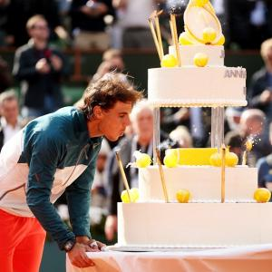 PHOTOS: Birthday boy Nadal takes the cake at Roland Garros