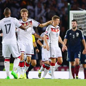 Euro qualifiers, PHOTOS: Germany put Scots on the rocks; Portugal win