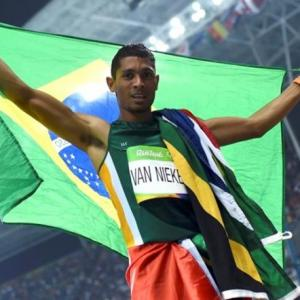 Van Niekerk breaks world record to win 400 gold