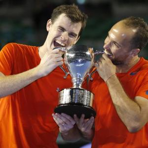 Big brother Murray sets the tone by clinching doubles crown