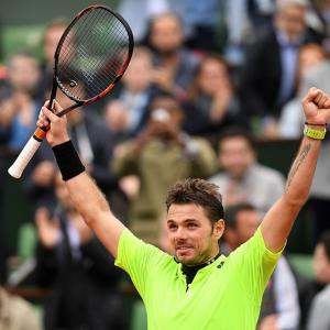 French Open PIX: Wawrinka, Muguruza reach quarters; Raonic ousted