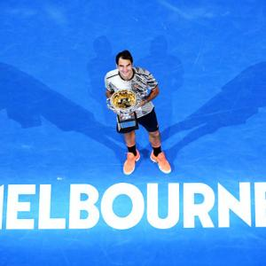 Emotional Federer savours long-awaited 18th slam win
