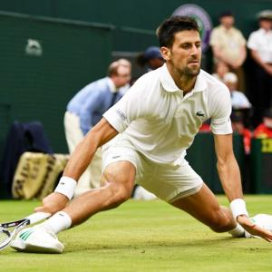 Djokovic complains about delay and 'hole' on Centre Court
