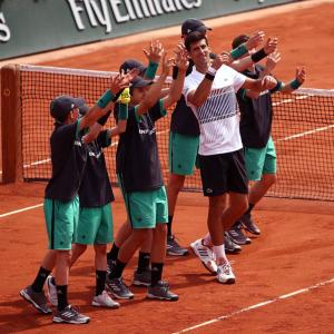 Djokovic makes winning French Open start on Agassi's watch