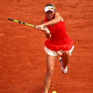 French Open PHOTOS: Wozniacki survives scare, Muguruza advances