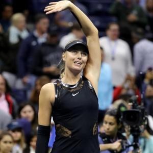Sharapova back in business on and off court