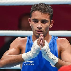 Asiad Boxing: Amit soldiers into final, injured Vikas settles for bronze