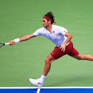 US Open PIX: Federer, Djokovic advance; Wozniacki crashes out