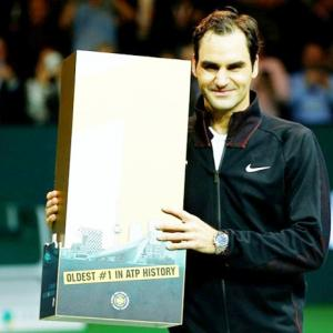 Back on top, Federer becomes oldest ATP world number one